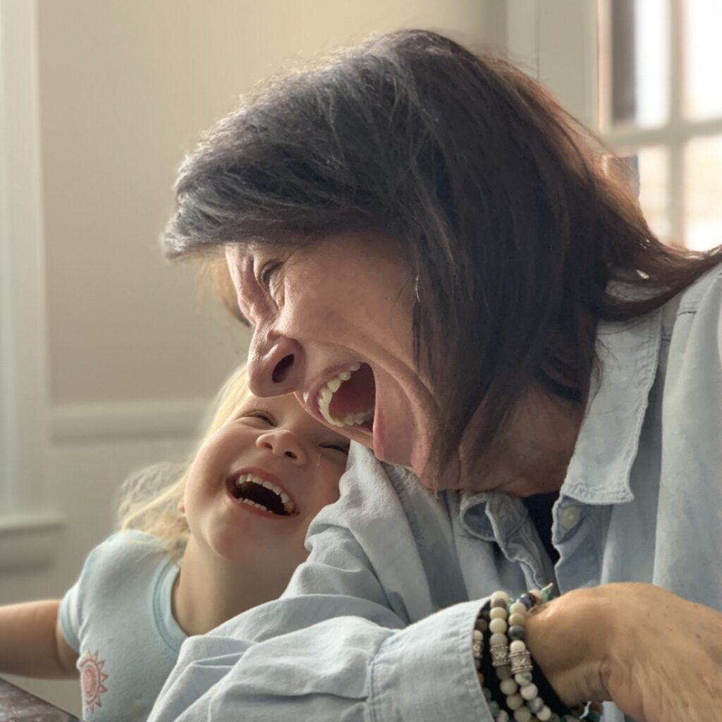 Janie Lees laughing with her granddaughter